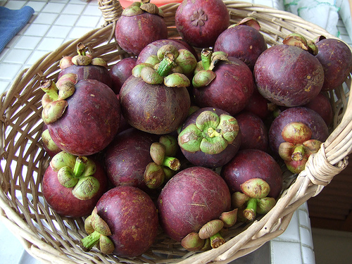A bowl of purple mangosteens